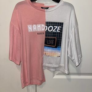 pink and white shirt, made with one side longer.